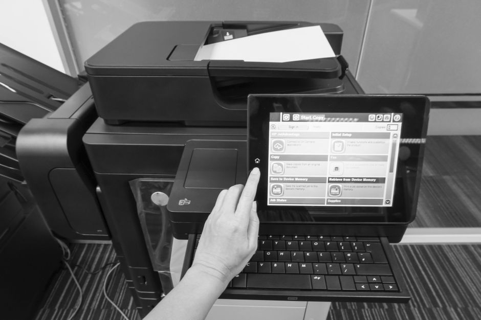 woman press on printer touchscreen to scan documents
